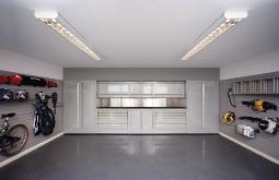 Garage doors choose from wooden and steel designs for Garage interior designs uk